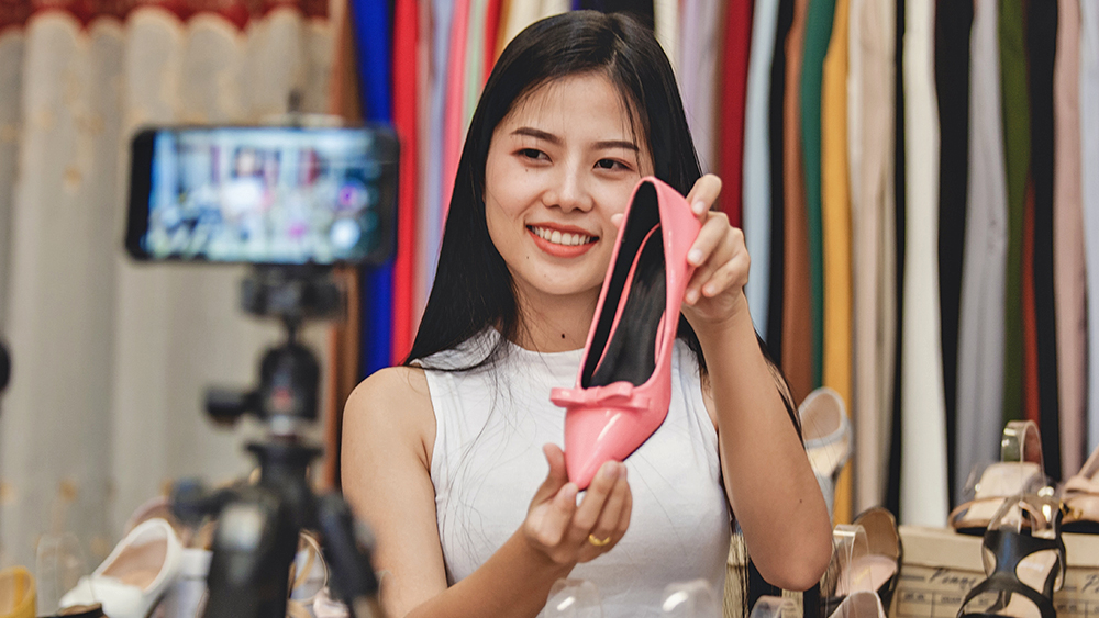 Woman live selling shoes